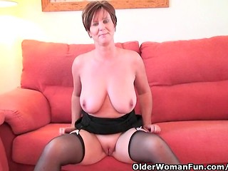 Mature woman in black dress exposing her boobs and yummy pussy