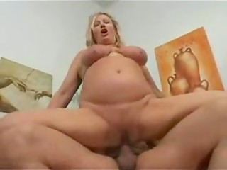 Mature woman with huge breast gratefully participates in her vintage sex-scene with young lover