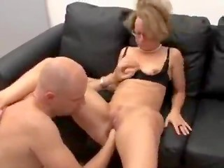Bald man anally penetrates his good-looking lady with glasses and finishes on her fucking face