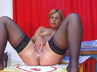 Young German blonde chick in stockings squirts at every opportunity in the amateur video