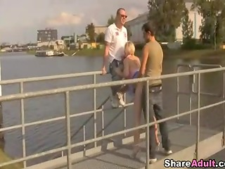 Horny guys banging amateur blonde chick in her mouth and pussy in the public place