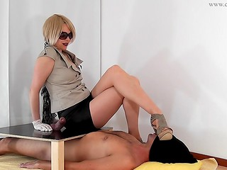 Sexy mistress in white gloves gives her slave nice handjob