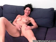 Smiling mature temptress demonstrates her genital bushes and sucks fingers in the amateur porn