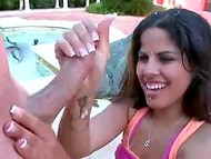 Juicy Brazilian chick presented her boyfriend the first-class handjob by the poolside