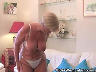 Smiling grannie took off panties and starts to masturbate her shaved pussy using small white vibrator 4