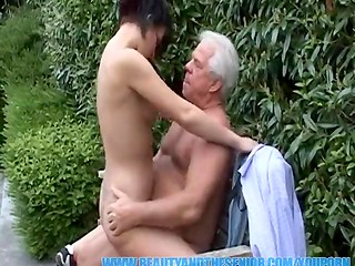 Gray-haired senor read newspaper and pounded his young brunette neighbor with natural tits on the bench