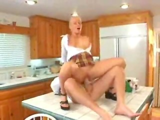 Jodie Moore in plaid mini skirt gets laid in the kitchen