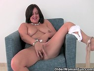 Chubby mature brunette slowly takes off her clothes and demonstrates hot treasures