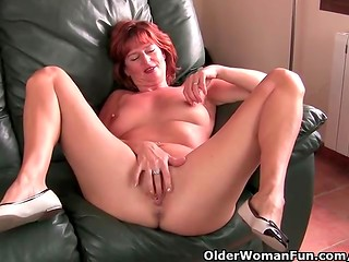 Mature redhead lady bares her boobs and rubs her pussy in the solo masturbation video