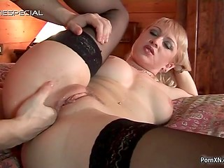 Blonde MILF in the stockings got hot anal fisting and fucking action in the cozy wooden house