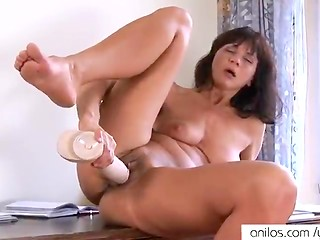 Mature brunette is tired of her dull husband and decided to achieve real orgasms using a dildo