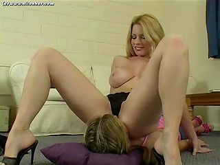 Busty blonde MILF dominates young girlfriend and sits on her face getting real pleasure