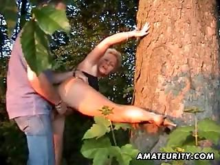 Mature blonde gets shagged under tree