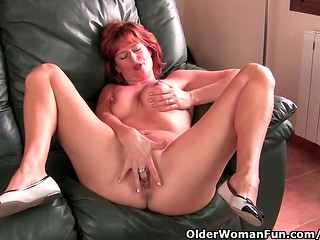 Mature redhead gal strokes her pussy slowly