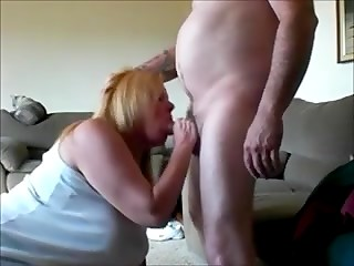 Cat watched how the busty housewife was presenting her fat husband the deepthroat blowjob in the amateur video