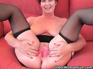 Mature bitch with big boobs lifting her little black dress up and showing pink pussy