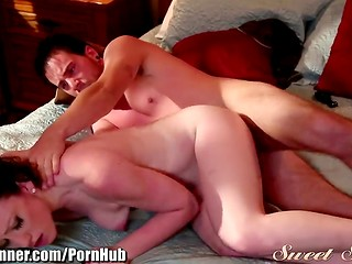 Beautiful young brunette makes love to handsome boyfriend in the parents' bedroom
