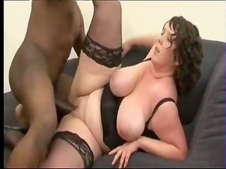 Pale-skinned fatty girl with huge tits and black fucker