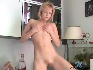 Blonde hottie remains alone at home and starts rubbing her shaved pussy on the camera