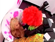Pretty blonde babe gets covered with sperm after wonderful assfucking action with a funny clown  10