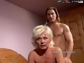 Mature blonde seduces a young guy, fucks him and drinks his cum