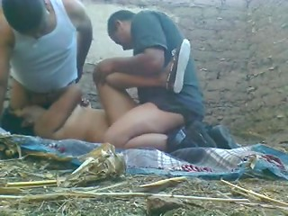Two amateur men with fat bellies sharing plump lady in the barn