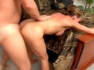 MILF blonde takes initiative in bed and jumps on man's cock