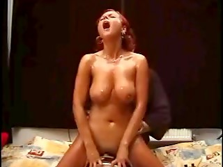 Nice redhead MILF in red bra and knickers gets machine fucked