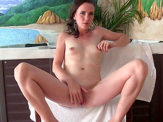 Sylvia Chrystall with small buds relaxing in the jacuzzi then masturbating her hole