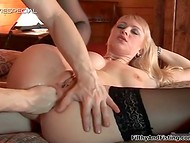 Blonde MILF receives fisting before being anally penetrated in the country house