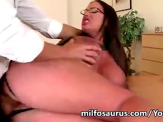 Bespectacled brunette with big tits fucks on office desk then gets her boobies jismed