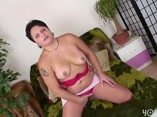 Brave youngster fucks his shot-haired neighbor with huge boobs in her bed