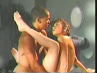 Young black boy and fascinating white madame in the vintage interracial scene