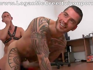 Tattooed Logan McCree gets his ass covered in candlewax and then fucked by Heiko Braun