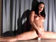 Flexible brunette woman seats on a skin colored dildo and jumps until she cums