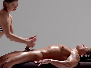Masseuse gives her client's cock a half-hour massage
