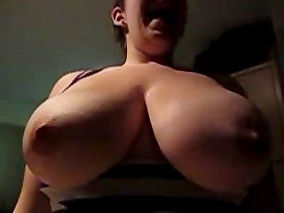 Amateur female shakes her huge natural breasts in the slow-motion movie