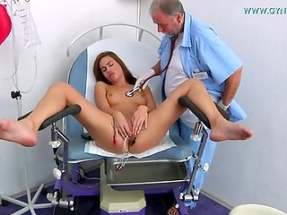 Sexy Jenny with shaved pussy gets her vagina examined by old nasty doctor