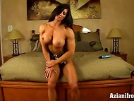 Muscled lady Angela Salvagno masturbating shaved pussy and showing her tits
