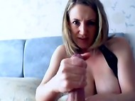 Busty MILF milking her breast and rubing her naughty hands against slim cock