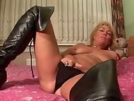 Mature blonde woman masturbated her dusty cunt with a cute pink dildo