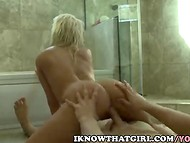 Pretty blonde bitch Larissa with sweet forms stimulates her pussy in the shower before her fucker appears