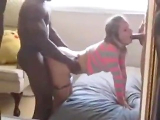 Young lady sucks her lover's black cock, gives him in doggy style pose and swallows white dick at the same time