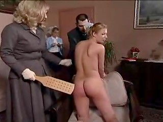 Young daughter looks weird and has to endure the pain because of hot spanking by her mother
