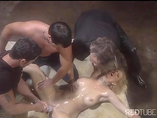 Four gays banging oiled up blonde chick and double penetrating her holes