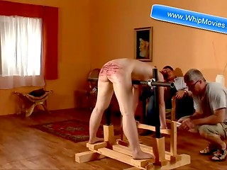 Cruel spanking game: poor brunette gets her ass punished hard