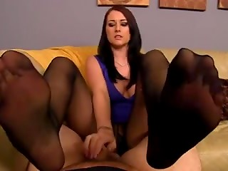 Brunette babe Alexis Grace in black pantyhose gives hot foot and handjob