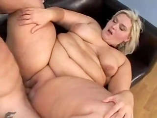 Сгеу blonde BBW rides her handsome sex partner's dick and gets a lot of pleasure