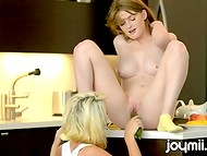 Red-haired cook with natural tits masturbated tasty pussy of her sexy lesbian using a big cucumber