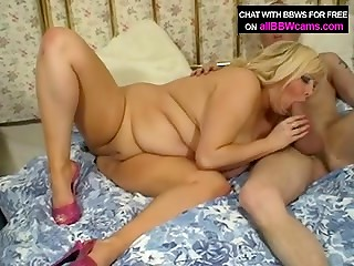 Appetizing blonde BBW with giant boobs banging on bed